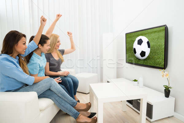 Trois femmes regarder football match Photo stock © AndreyPopov