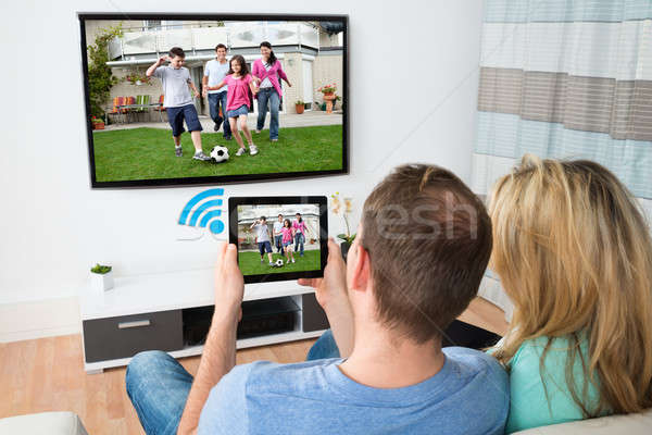 Couple Connecting Television And Digital Table With Wifi Stock photo © AndreyPopov