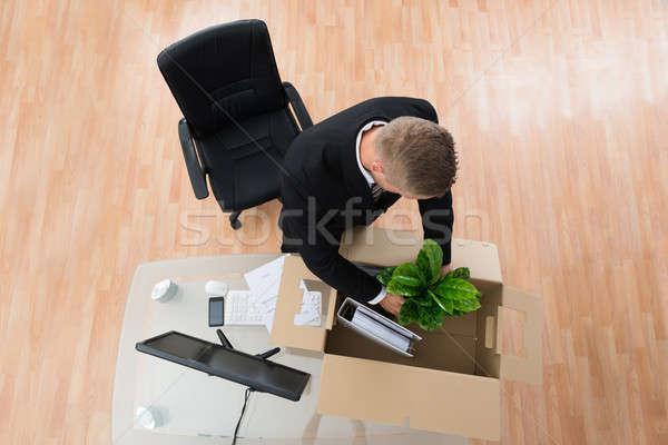 Businessman Packing Belongings In Cardboard Box Stock photo © AndreyPopov