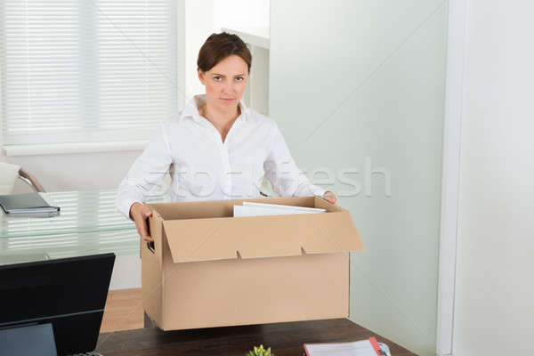 Businesswoman Packing Her Belongings Stock photo © AndreyPopov