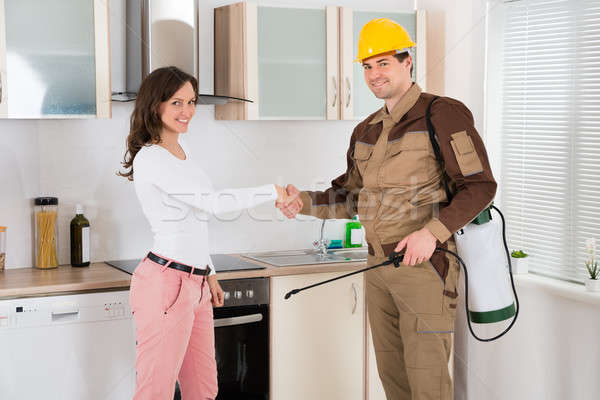 Woman And Pest Control Worker Shaking Hands Stock photo © AndreyPopov