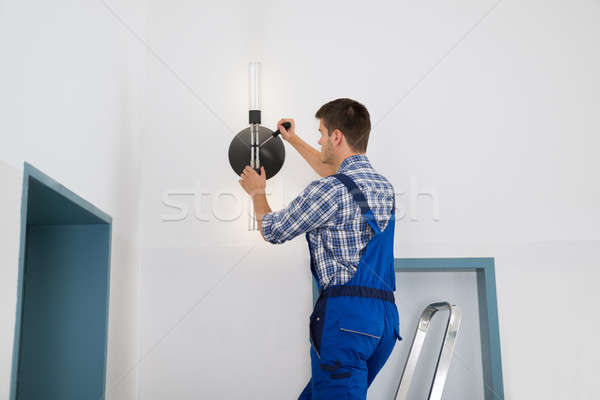 Electrician Repairing Light Stock photo © AndreyPopov