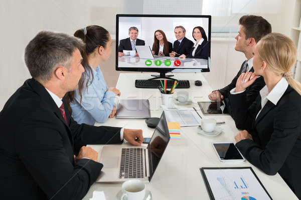 Businesspeople Watching An Online Presentation Stock photo © AndreyPopov