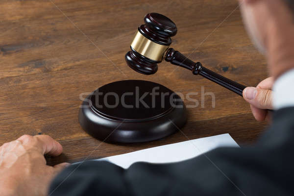 Judge Striking The Gavel At Table Stock photo © AndreyPopov