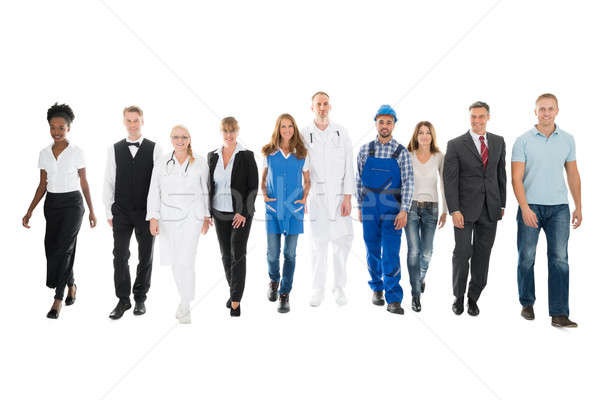 Confident People With Various Occupations Walking In Row Stock photo © AndreyPopov