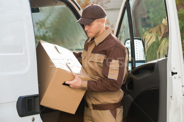 Delivery Man Removing Cardboard Box From Truck Stock photo © AndreyPopov