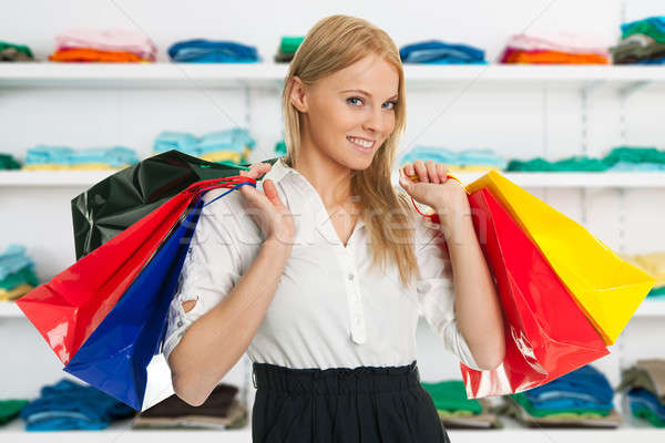 Happy Woman Carrying Shopping Bags Stock photo © AndreyPopov