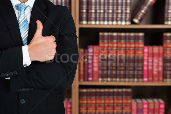 Midsection Of Lawyer Gesturing Thumbs Up Stock photo © AndreyPopov