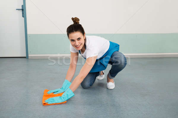 Female Janitor Cleaning Floor With Duster Stock photo © AndreyPopov