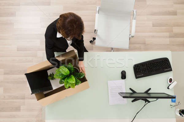 Businesswoman Packing Her Belongings In Box Stock photo © AndreyPopov