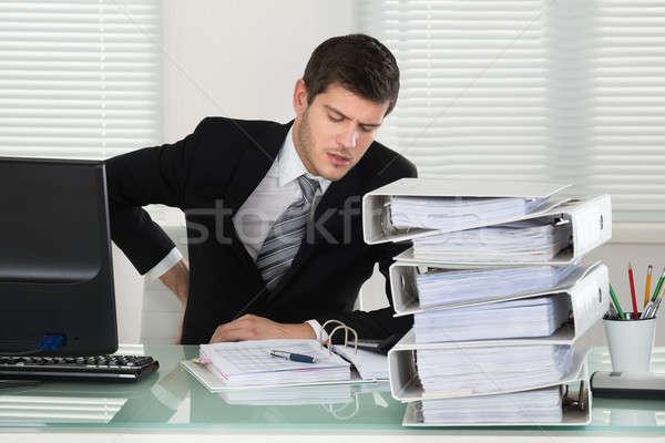 Empresário sofrimento dor nas costas secretária negócio Foto stock © AndreyPopov