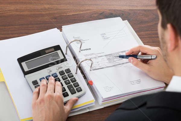 Businessman Analyzing Invoice Stock photo © AndreyPopov