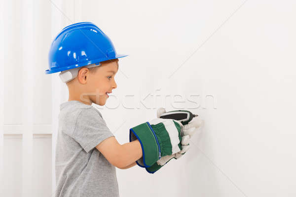 Little Boy Drilling Wall Stock photo © AndreyPopov