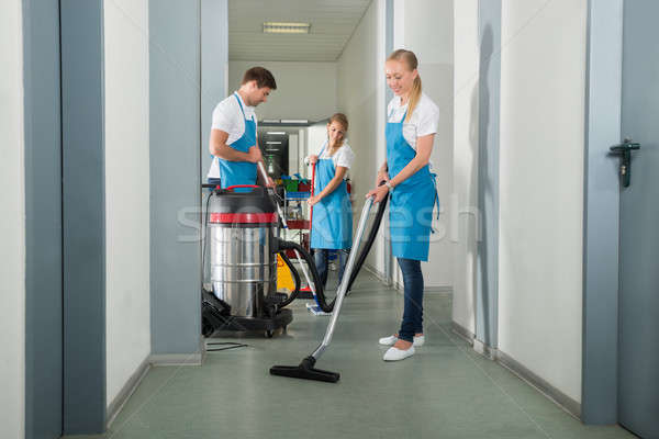 Group Of Janitors Cleaning Floor In Corridor Stock photo © AndreyPopov