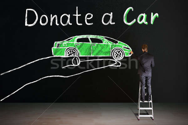 Businessman Drawing The Car Donation Concept Stock photo © AndreyPopov