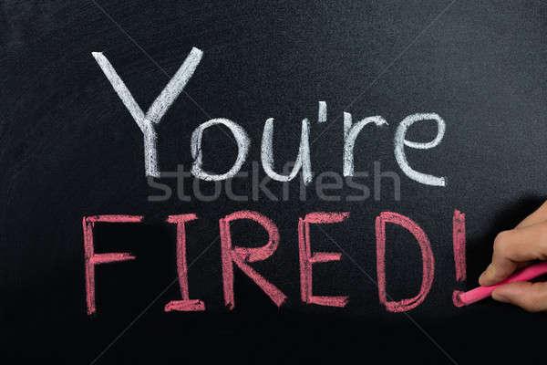 Fired Concept Written On Blackboard Stock photo © AndreyPopov