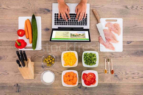 человек глядя рецепт используя ноутбук мнение Сток-фото © AndreyPopov