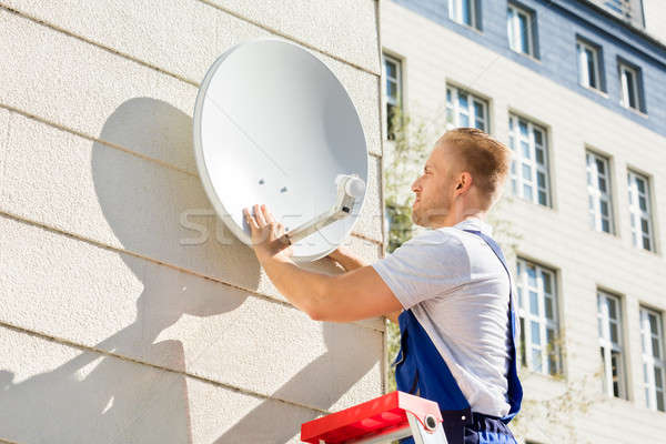 Man Fitting TV Satellite Dish Stock photo © AndreyPopov