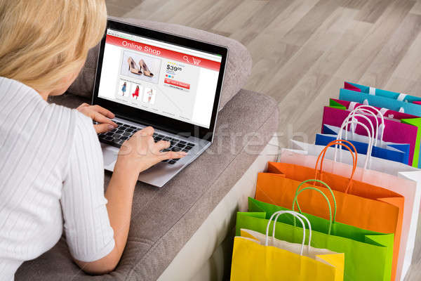 close up of woman shopping online using laptop stock photo andriy popov andreypopov. Black Bedroom Furniture Sets. Home Design Ideas