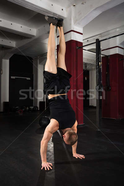 Young Man Doing Handstand Exercise Stock photo © AndreyPopov