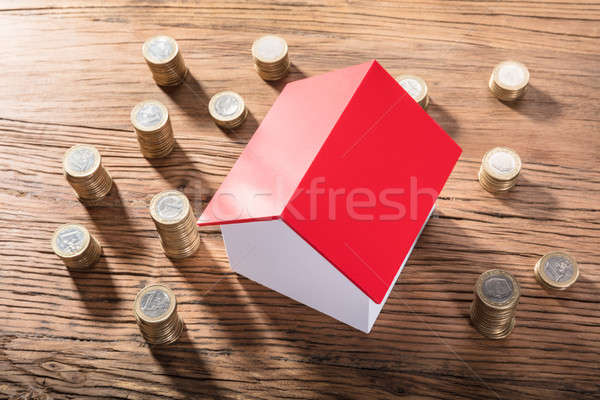 House Model Surrounded With Coin Stacks Stock photo © AndreyPopov