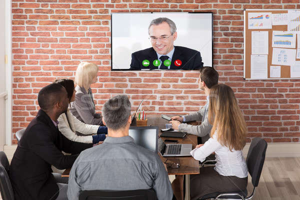Business Team Having Video Conference Stock photo © AndreyPopov