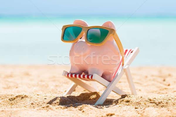 Kumbara ahşap güneş gözlüğü güverte sandalye pembe Stok fotoğraf © AndreyPopov