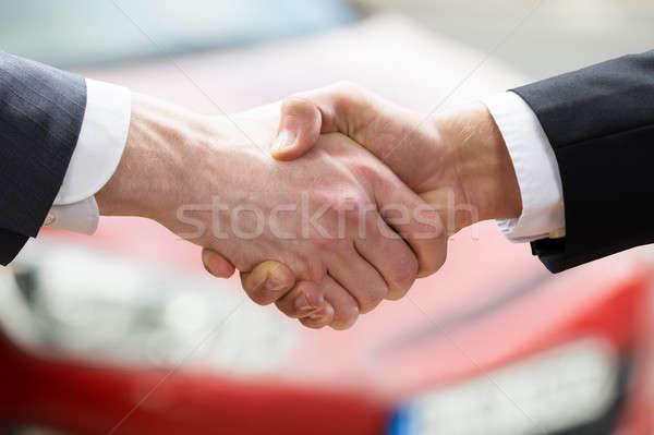Venditore stringe la mano client auto primo piano Foto d'archivio © AndreyPopov