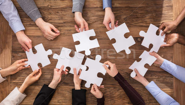 Businesspeople Hand Solving Jigsaw Puzzle Stock photo © AndreyPopov