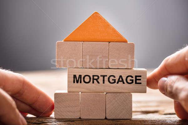 Kezek épület ház modell jelzálog közelkép Stock fotó © AndreyPopov