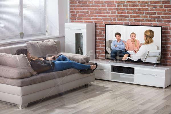 Nő tv nézés fiatal nő fektet kanapé otthon Stock fotó © AndreyPopov