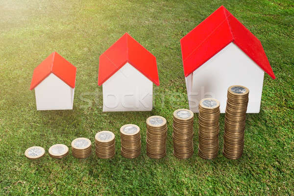Stack Of Coins In Front Of House Model Stock photo © AndreyPopov
