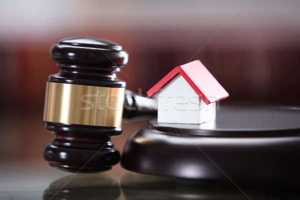 Gavel With Small House Model Stock photo © AndreyPopov