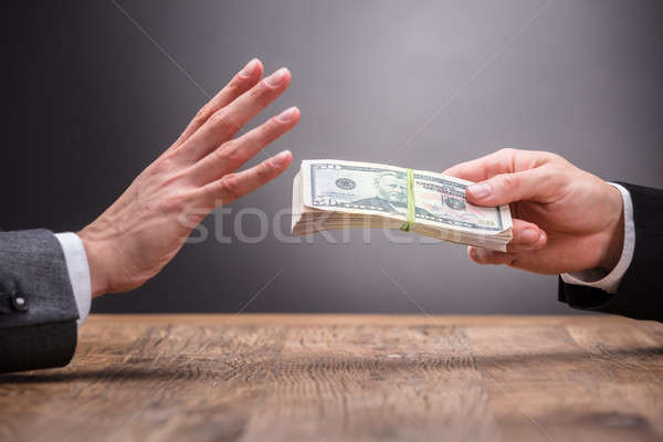Businessperson Refusing To Take Bribe From Partner Stock photo © AndreyPopov