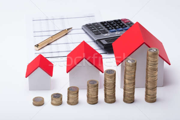 Stack Of Coins In Front Of House Model And Documents Stock photo © AndreyPopov