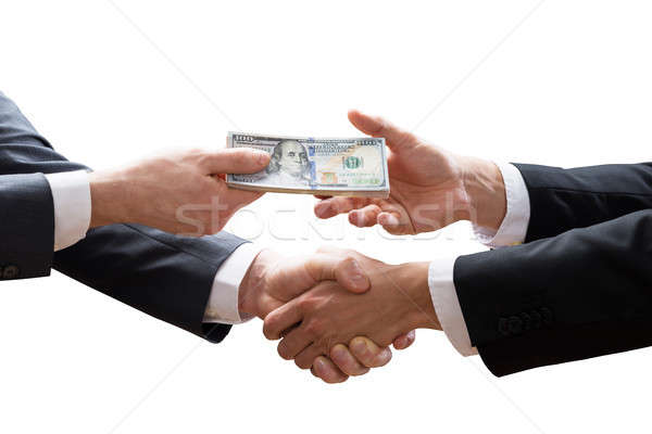 Two Businesspeople Shaking Hands And Receiving Banknote Stock photo © AndreyPopov