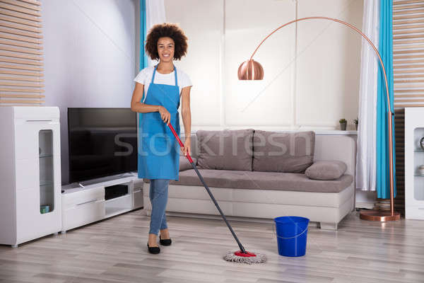 Housekeeper Cleaning Floor With Mop Stock photo © AndreyPopov