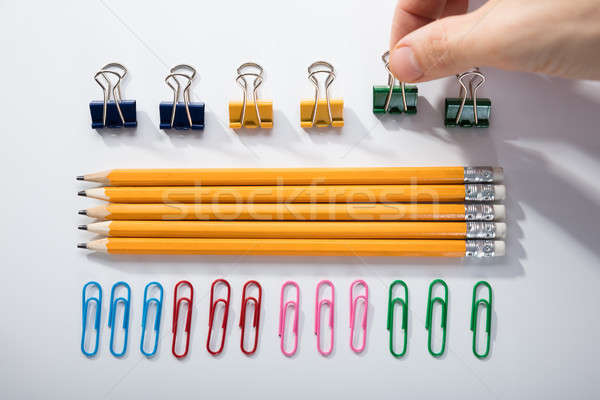 Person Arranging The Pencils On White Background Stock photo © AndreyPopov