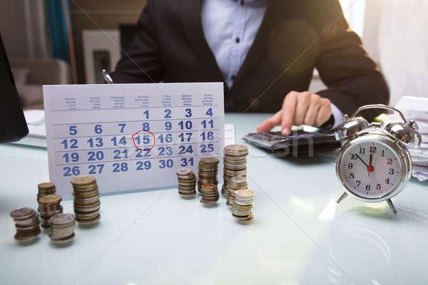 Primo piano monete calendario mano business Foto d'archivio © AndreyPopov