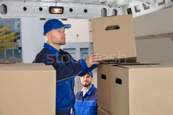Mover Unloading Cardboard Box From Truck Stock photo © AndreyPopov