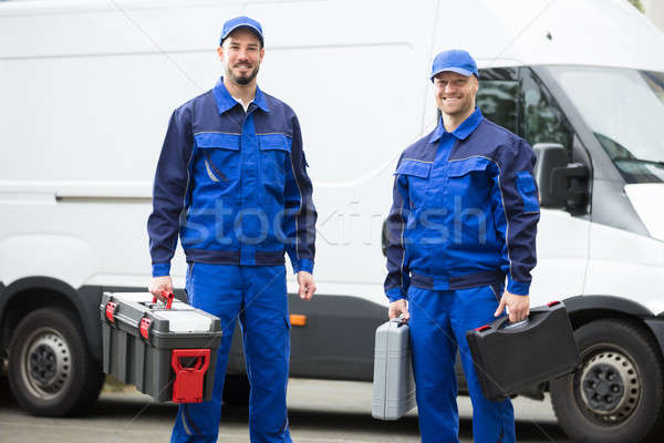 Happy Male Workers Holding Toolboxes Stock photo © AndreyPopov