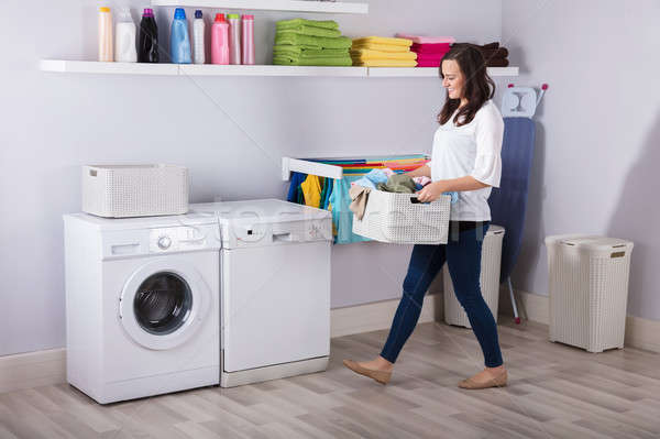 Woman Standing Near Washing Machine With Basket Of Clothes Stock photo © AndreyPopov