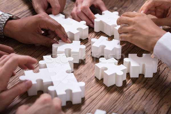 Businesspeople Solving Jigsaw Puzzle Together Stock photo © AndreyPopov