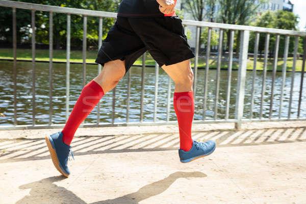 Man Running On Sidewalk At Morning Stock photo © AndreyPopov