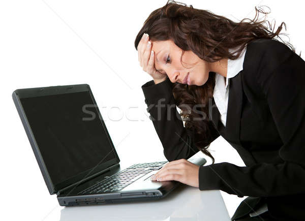 Stressful business woman working on laptop Stock photo © AndreyPopov