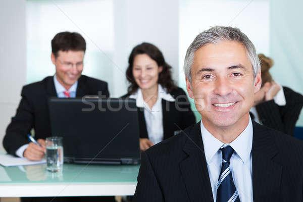 Corporate promotie leiderschap geslaagd knap glimlachend Stockfoto © AndreyPopov
