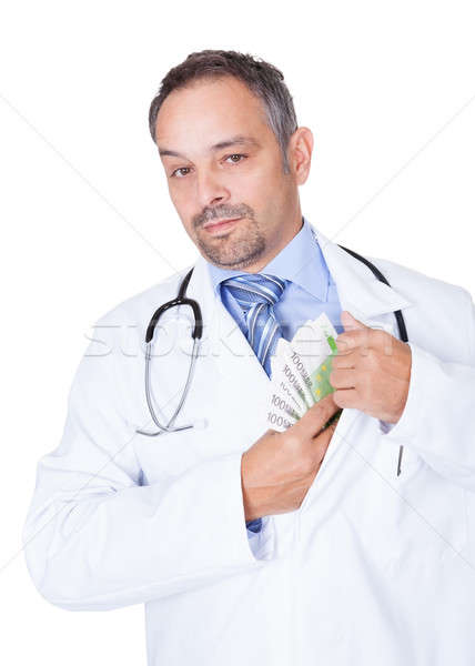 Happy Doctor Holding Euro Notes Stock photo © AndreyPopov