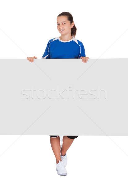 Nő tart plakát boldog fiatal nő fehér Stock fotó © AndreyPopov