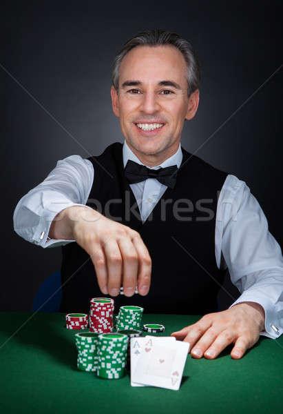 Portrait of a happy croupier Stock photo © AndreyPopov