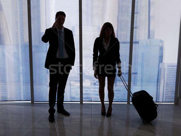 Empresario llamada pie colega equipaje oficina Foto stock © AndreyPopov